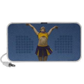 Female cheerleader jumping in air, front view travelling speakers