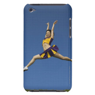 Female cheerleader jumping in air iPod touch cover