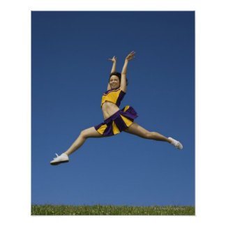 Female cheerleader jumping in air poster