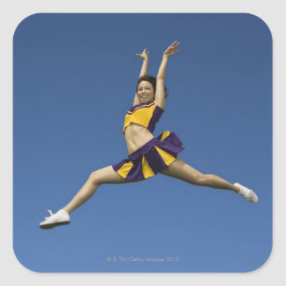 Female cheerleader jumping in air square sticker