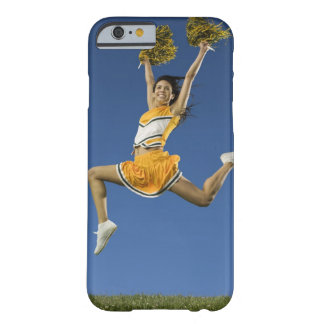 Female cheerleader jumping in air with pompoms barely there iPhone 6 case