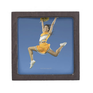 Female cheerleader jumping in air with pompoms keepsake box
