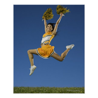 Female cheerleader jumping in air with pompoms poster