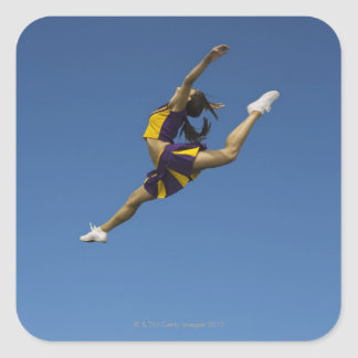 Female cheerleader leaping high up in air square sticker