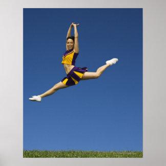 Female cheerleader leaping in air poster