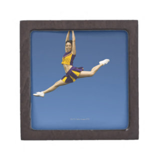 Female cheerleader leaping in air premium gift boxes