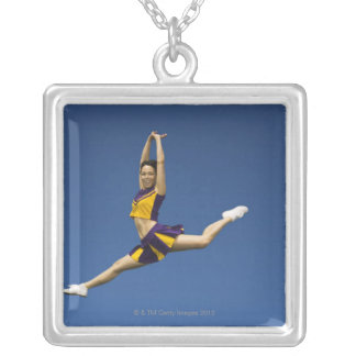 Female cheerleader leaping in air square pendant necklace
