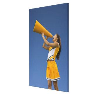 Female cheerleader shouting into megaphone gallery wrap canvas
