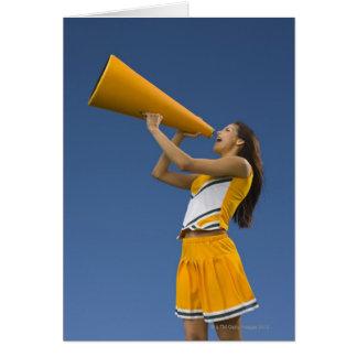Female cheerleader shouting into megaphone card