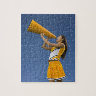 Female cheerleader shouting into megaphone jigsaw puzzle