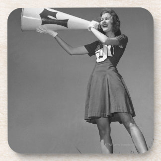Female cheerleader using megaphone beverage coaster