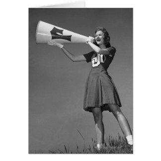 Female cheerleader using megaphone card