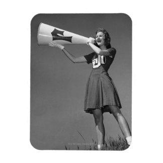 Female cheerleader using megaphone magnet