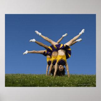 Female cheerleaders doing handstands poster