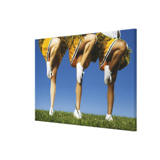 Female cheerleader's legs (low section) canvas print