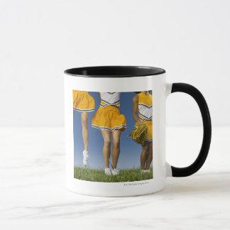 Female cheerleader's legs  (low section) mug