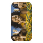 Female cheerleaders lying on grass with pompoms iPhone 4 covers