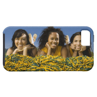 Female cheerleaders lying on grass with pompoms iPhone SE/5/5s case