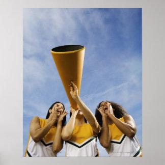 Female cheerleaders shouting through megaphone, print