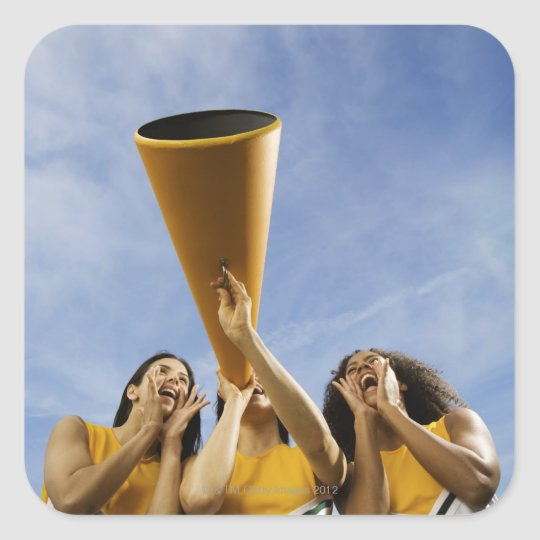 Female cheerleaders shouting through megaphone, square sticker