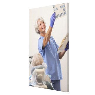 Female dental hygienist examining an X-Ray Canvas Print