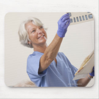 Female dental hygienist examining an X-Ray Mouse Pad