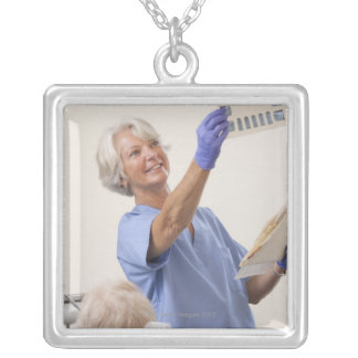 Female dental hygienist examining an X-Ray Silver Plated Necklace
