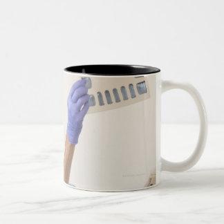 Female dental hygienist examining an X-Ray Two-Tone Coffee Mug