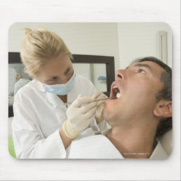 Female dentist examining man mouse pad