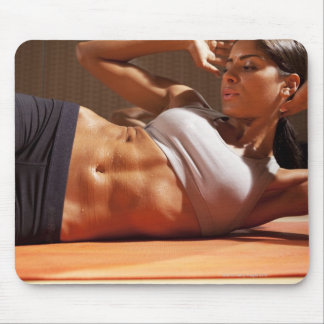 Female doing intense crunches, mouse pad