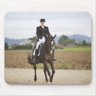 female dressage rider exercising mouse pad