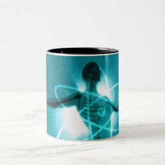 Female figure with an overlay of an atomic symbol Two-Tone coffee mug
