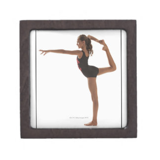 Female gymnast (12-13) balancing on one leg gift box