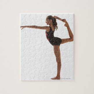 Female gymnast (12-13) balancing on one leg jigsaw puzzle