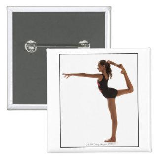 Female gymnast (12-13) balancing on one leg pinback button