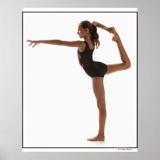 Female gymnast (12-13) balancing on one leg poster