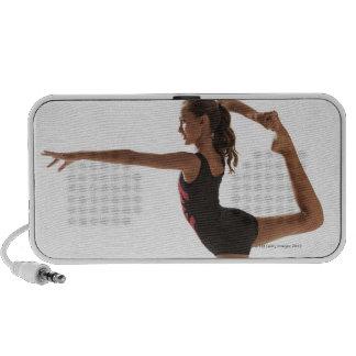 Female gymnast (12-13) balancing on one leg mini speaker