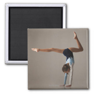 Female gymnast (12-13) performing handstand 2 inch square magnet