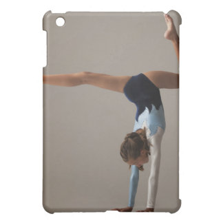 Female gymnast (12-13) performing handstand cover for the iPad mini
