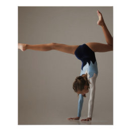 Female gymnast (12-13) performing handstand poster
