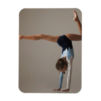 Female gymnast (12-13) performing handstand rectangular photo magnet