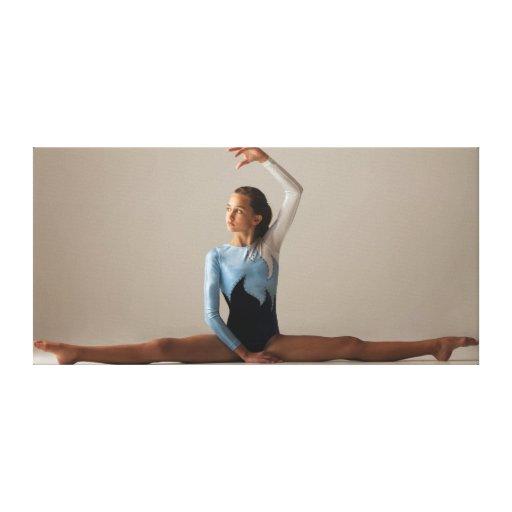 Female gymnast (12-13) performing splits canvas print