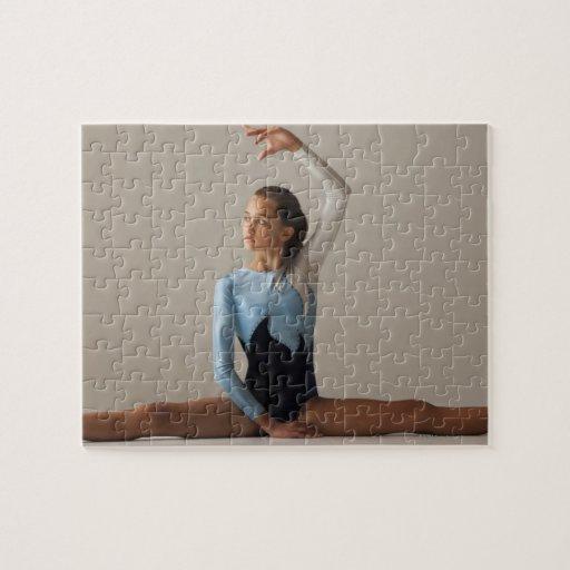 Female gymnast (12-13) performing splits jigsaw puzzle