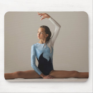 Female gymnast 12-13 performing splits mouse pads
