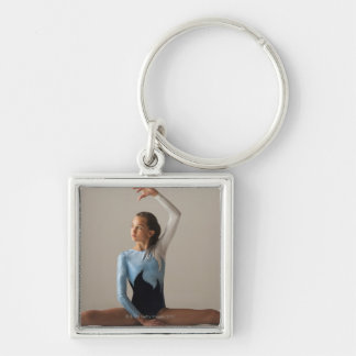 Female gymnast (12-13) performing splits Silver-Colored square keychain