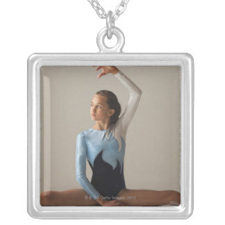Female gymnast (12-13) performing splits silver plated necklace