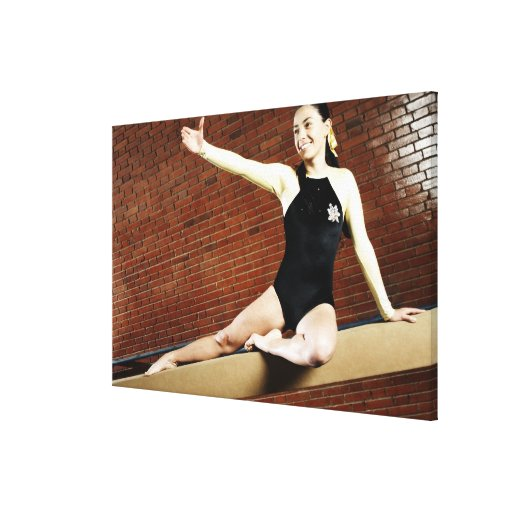 Female gymnast practicing on a balance beam and gallery wrapped canvas