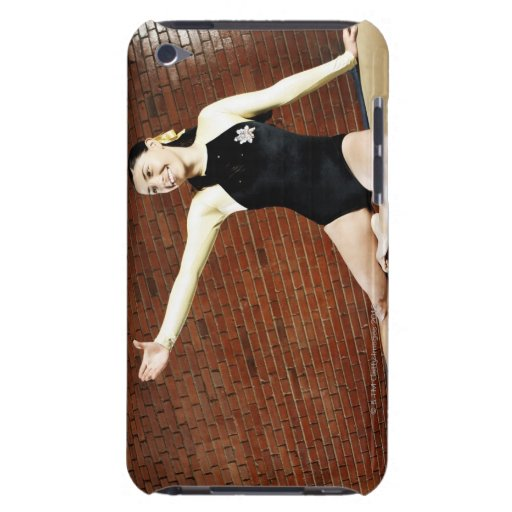 Female gymnast practicing on a balance beam and barely there iPod covers