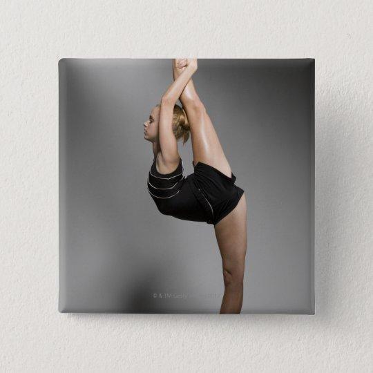 Female gymnast stretching, studio shot pinback button
