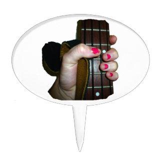 Female hand holding four string bass neck cake topper
